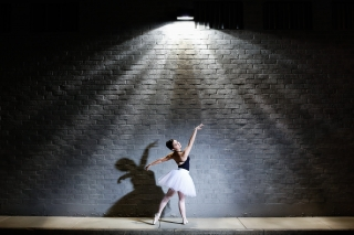 UGA college bound high school senior dances around the city streets for her senior pictures by Starr Petronella.