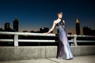 Roswell High School Senior girl takes the night by storm with her prom dress and Atlanta skyline. Images by Urban Flair Photography