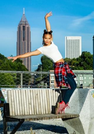 Watts preforming her gymnastics routine